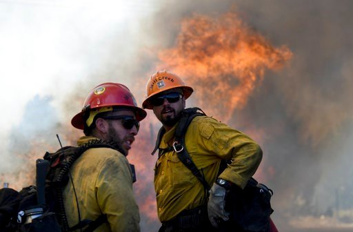 Members of the Mill Creek Hot Shots prepare to battle a wildfire near Big Bear, Calif., Tuesday, June 20, 2017. (James Quigg/The Daily Press via AP).