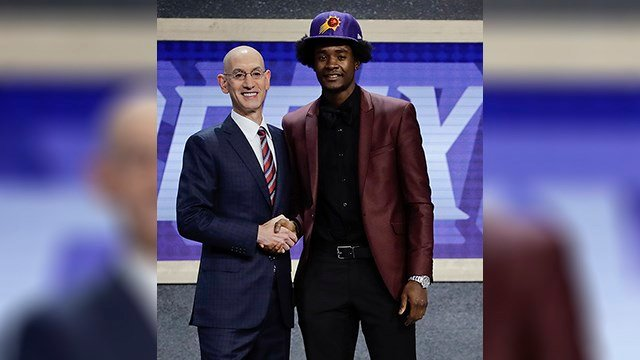 Kansas' Josh Jackson, right, poses for a photo with NBA Commissioner Adam Silver after being selected by the Phoenix Suns as the fourth pick overall during the NBA basketball draft, Thursday, June 22, 2017, in New York. (AP Photo/Frank Franklin II)