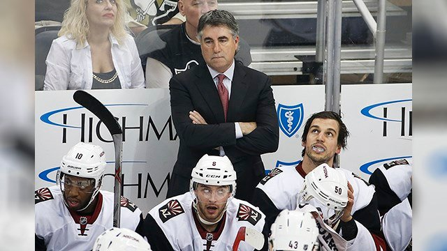 Arizona Coyotes head coach Dave Tippett stands behind his bench during an NHL hockey game against the Pittsburgh Penguins in Pittsburgh, Monday, Feb. 29, 2016. (AP Photo/Gene J. Puskar)