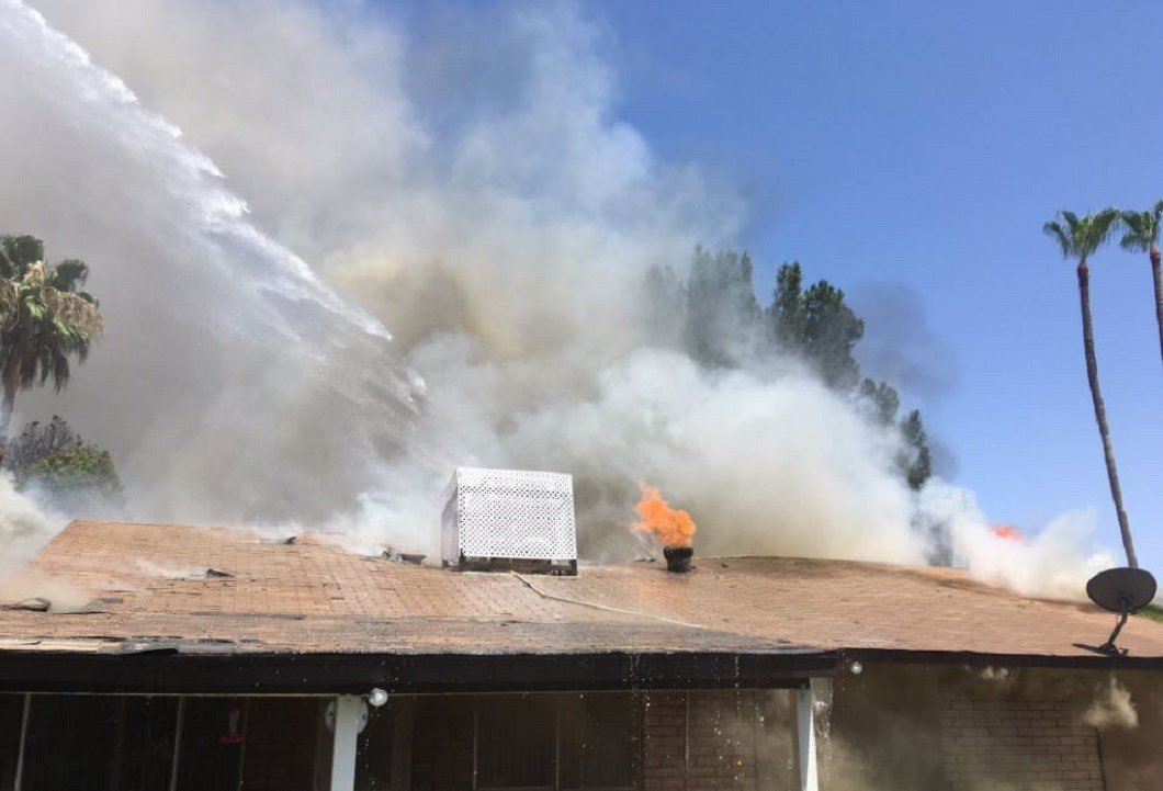 Fire fighters battle an attic fire in Scottsdale Friday afternoon. (23 June 2017) [Source: Scottsdale Fire Dept.]