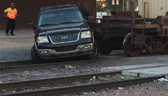 An SUV was hit by a train on the tracks at Grand and 51st avenues. (Source: 3TV/CBS 5)