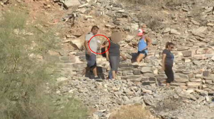 A woman is see throwing a water bottle on the ground while hiking at Piestewa Peak on Saturday, June 17. (Source: 3TV/CBS 5)