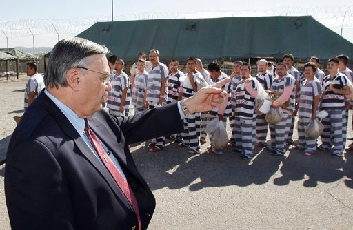 FILE-In this Feb. 4, 2009 file photo, Maricopa County Sheriff Joe Arpaio, left, orders approximately 200 convicted illegal immigrants handcuffed together in Tent City in Phoenix. (Source: AP Photo/Ross D. Franklin, File)