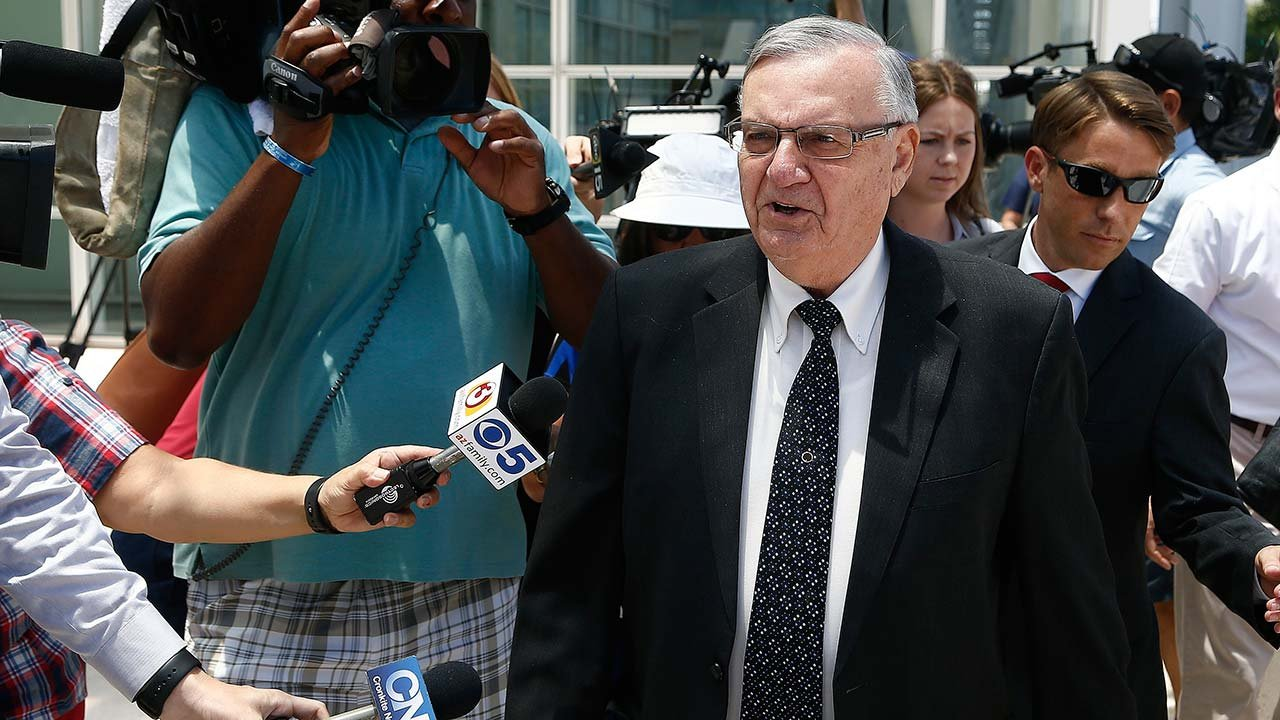 Former Maricopa County Sheriff Joe Arpaio, front right, leaves U.S. District Court on the first day of his contempt-of-court trial Monday, June 26, 2017, in Phoenix. (Source: AP Photo/Ross D. Franklin)