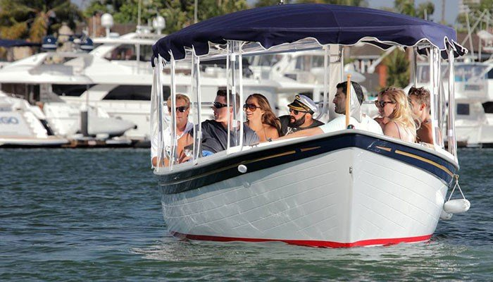 You can cruise the harbor in a Duffy. (Source: VisitNewportBeach.com)