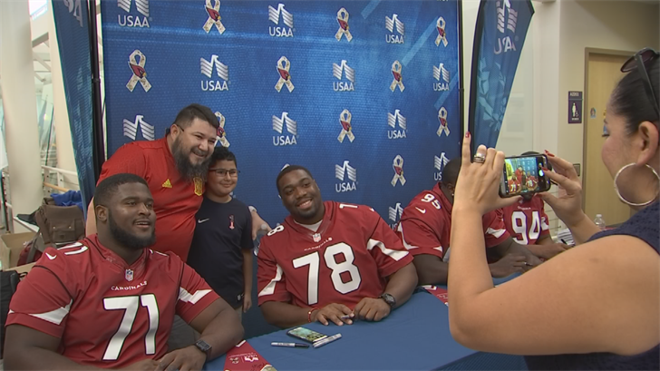The Cardinals' visit Wednesday was in conjunction with the USAA, the NFL's official military appreciation sponsor. (Source: 3TV/CBS 5)
