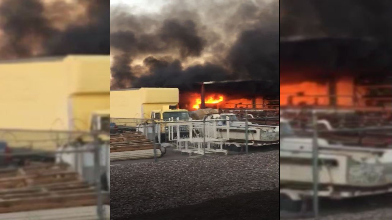An RV and semi-truck caught fire in a Phoenix industrial yard. (Source: Alberto)