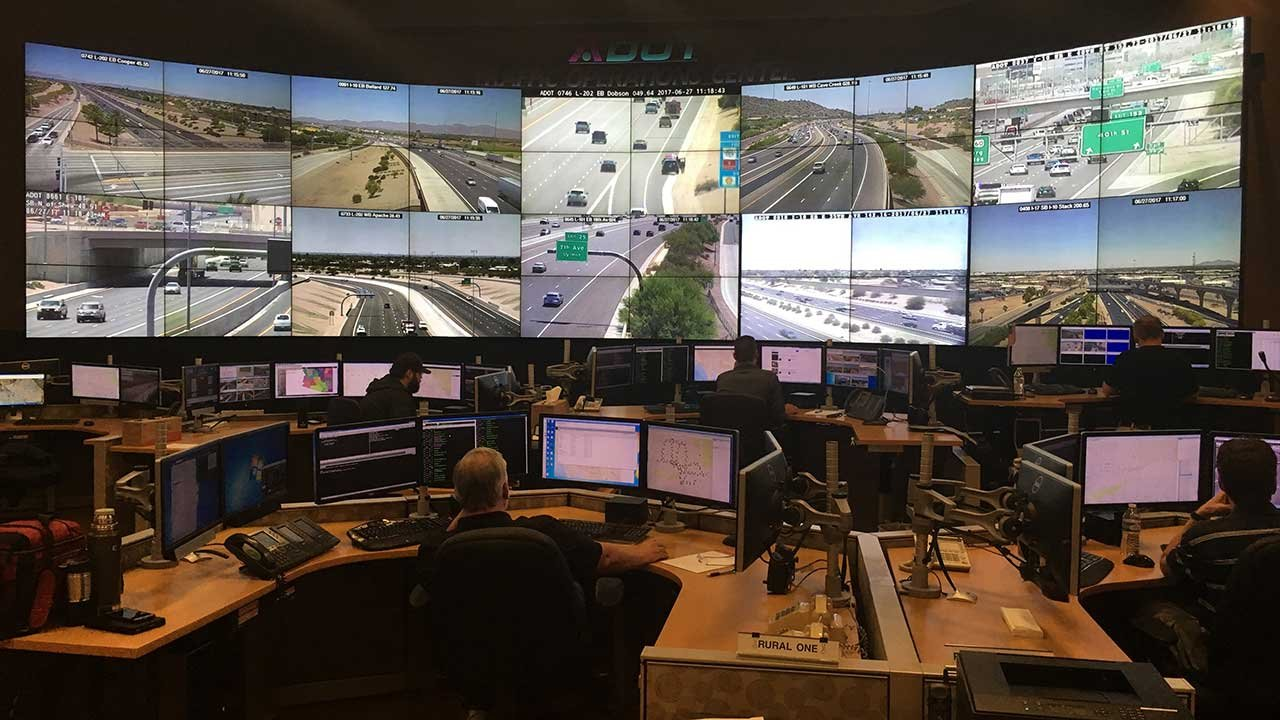 The ADOT Traffic Operation Center monitors traffic throughout Arizona. When a dust-storm detect system comes online in 2019, workers will be able to alert motorists to visibility issues. (Source: Tyler Fingert/Cronkite News)