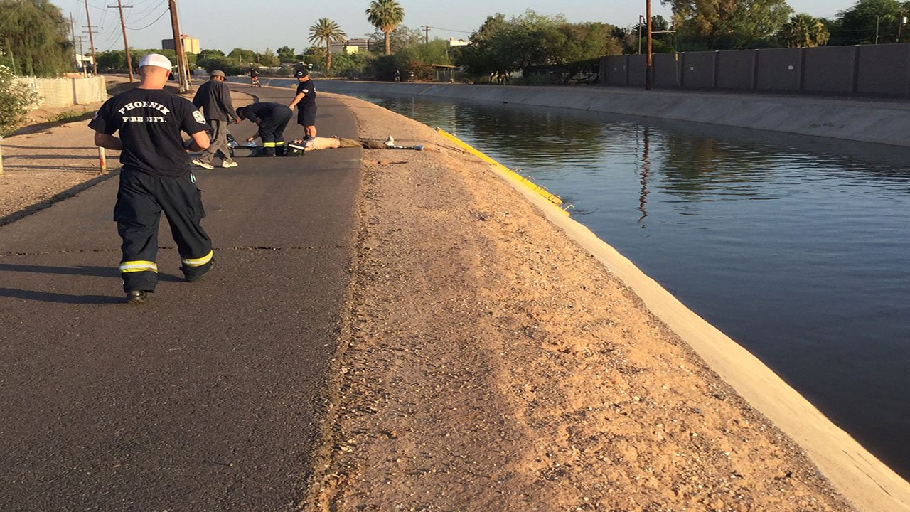 Phoenix firefighters transported an adult maleto a local hospital after pulling him out of a canal Monday morning. (Source: 3TV/CBS 5)