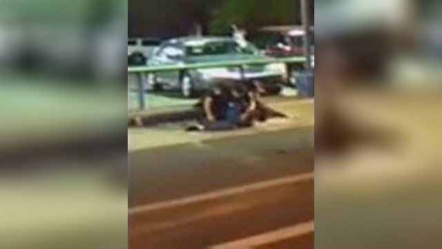 Blurry cell phone video shows a struggle between officers and a suspect, police said. (Source: 3TV/CBS 5)