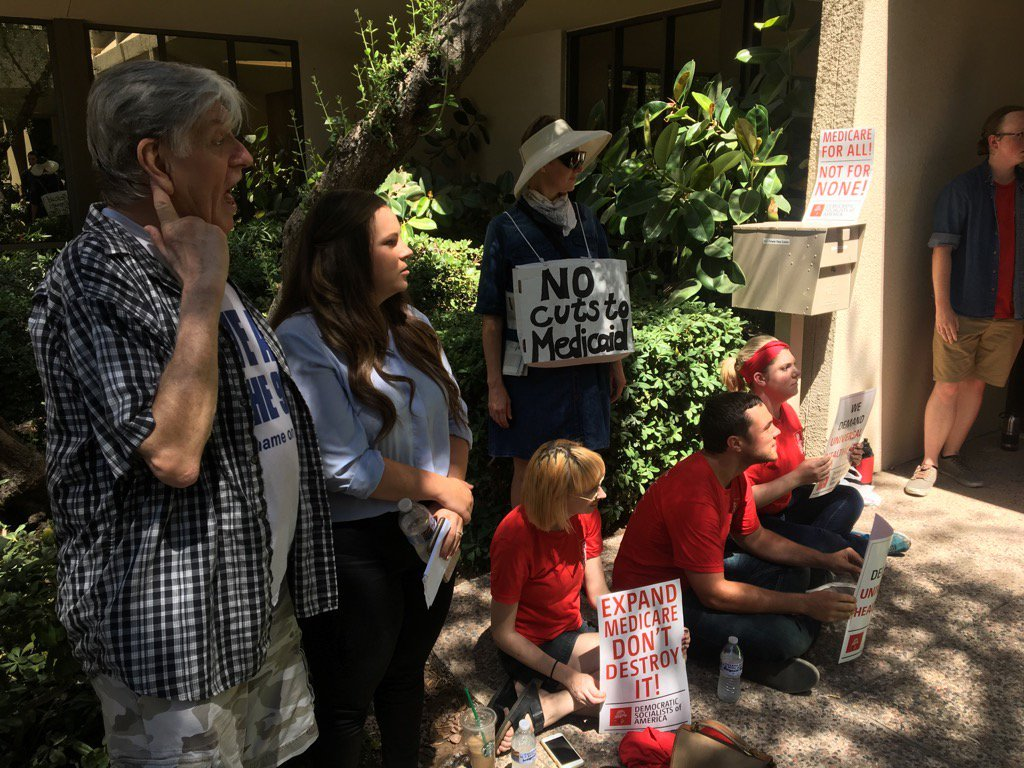 Health care protesters at Flake's Arizona offices arrested