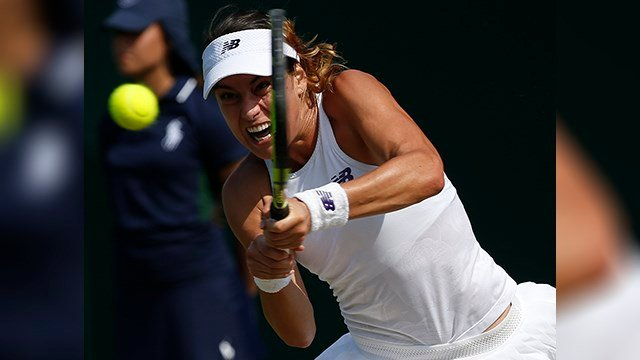 Romania's Sorana Cirstea returns to Bethanie Mattek-Sands of the United States during their Women's Singles Match on day four at the Wimbledon Tennis Championships in London Thursday, July 6, 2017. (AP Photo/Alastair Grant)