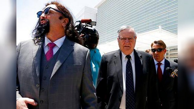 In this June 26, 2017, file photo, former Maricopa County Sheriff Joe Arpaio, second from right, leaves U.S. District Court on the first day of his contempt-of-court trial with attorney Mark Goldman, left, in Phoenix. (AP Photo/Ross D. Franklin, File)