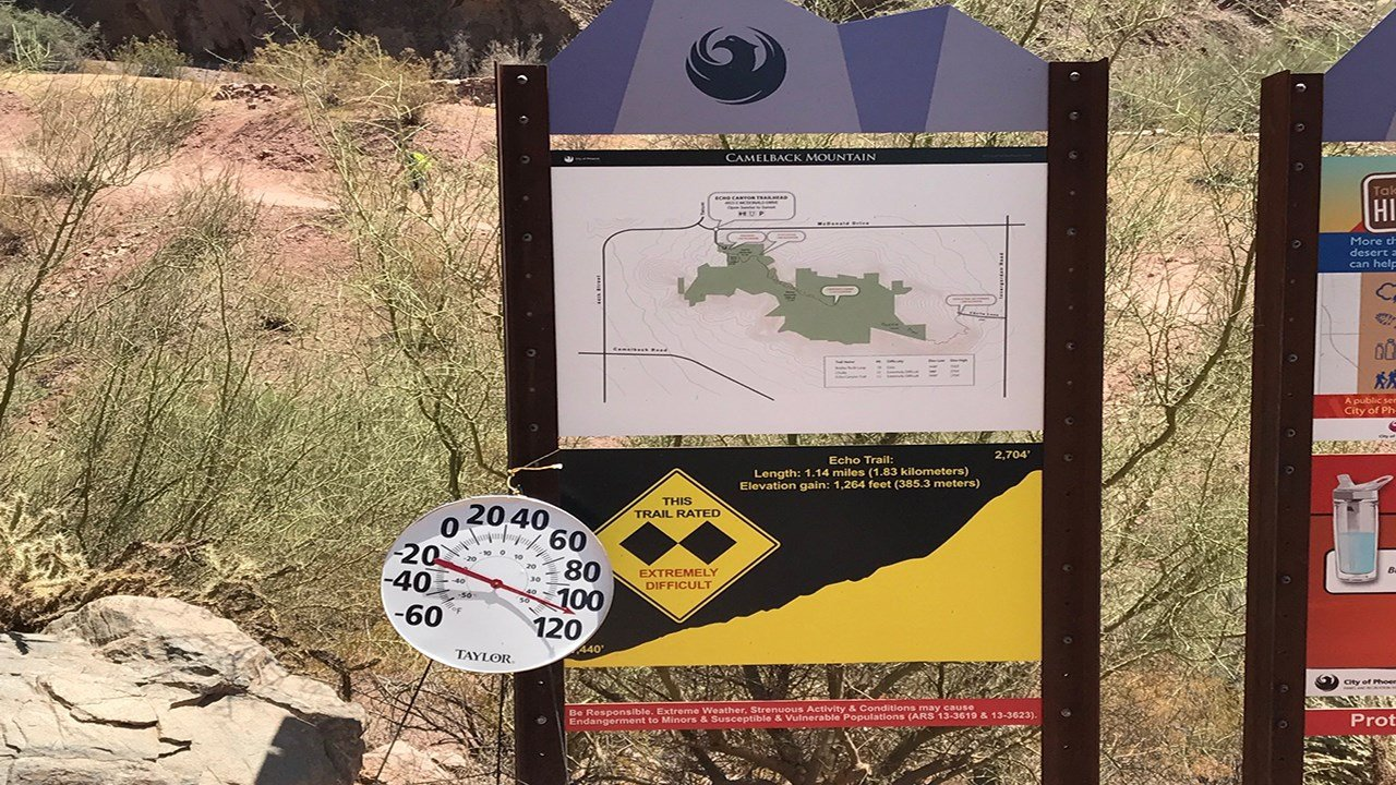 A sign at the trail head informs hikers about the dangers of hiking in the heat. (10 July 2017) [Source: Phoenix Fire Dept.]
