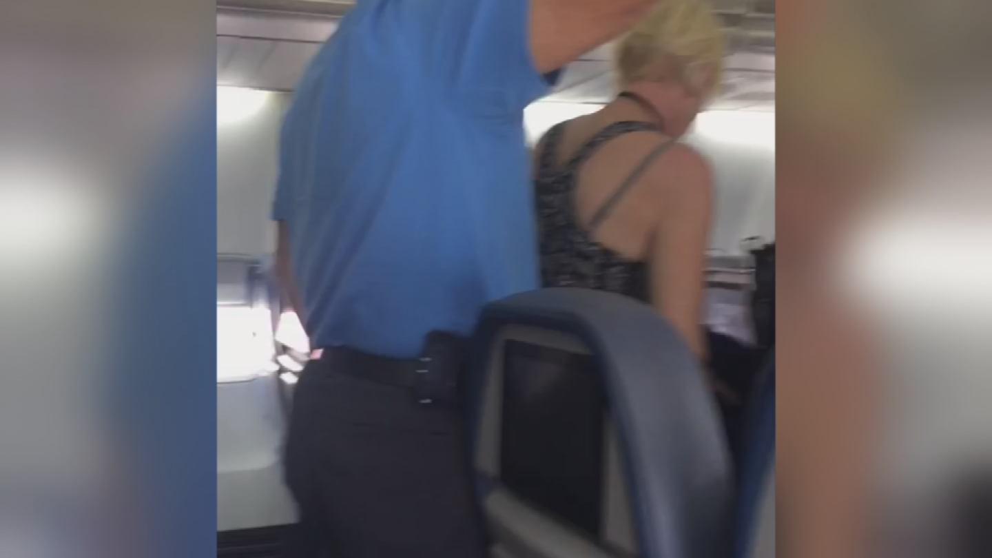 Passengers aren't supposed to get up from their seats before the casket is off the plane. (Source: 3TV/CBS 5)