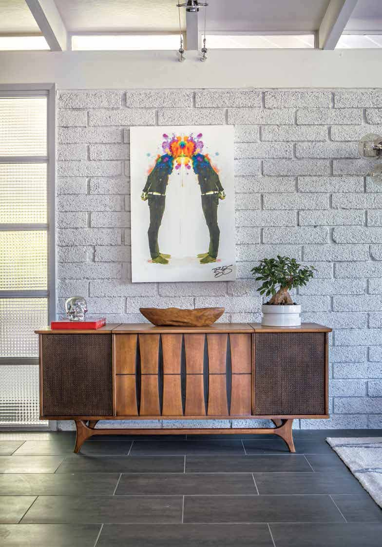 I found a couple of authentic pieces from the 1950s, like my record player/credenza that I found for cheap at Modern on Melrose in central Phoenix.  (Source: Phoenix Home & Garden)