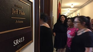 Protesters file into Sen. Flake's office where they spent about 20 minutes sharing their opposition to a Senate health care bill before heading out to demonstrate in the hallway, where several were later arrested. (Source: Megan Janetsky/Cronkite News)
