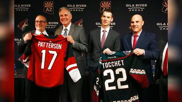 Arizona Coyotes owner Andrew Barroway, left, poses for a photograph with new team president and CEO, Steve Patterson, second from left, along with president of hockey operations John Chayka, second from right, and new coach Rick Tocchet, right. (AP Photo)