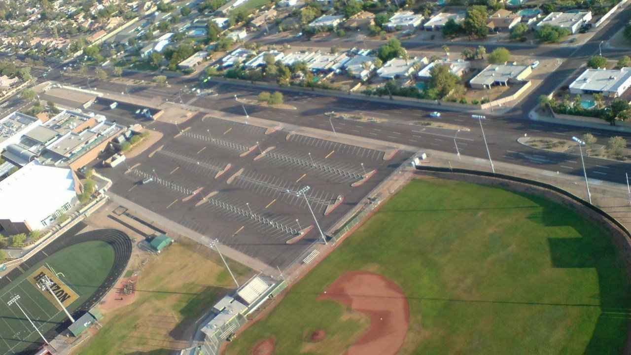 Arizona researchers of urban heat have discovered astroturf fields are substantially warmer than traditional grass fields. (Photo courtesy of Peter Crank and Mary Wright)