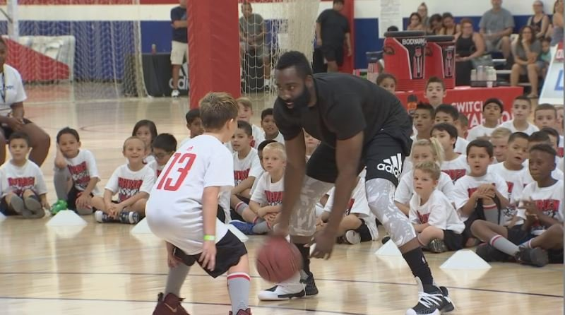 James Harden takes on one of his campers at Inspire Courts in Gilbert. (Source: 3TV/CBS 5)