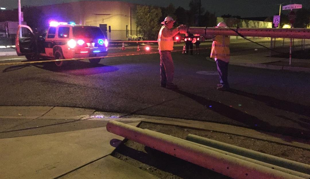 Crews work on a pole that was knocked over by strong winds in Phoenix. (Source: 3TV/CBS 5)