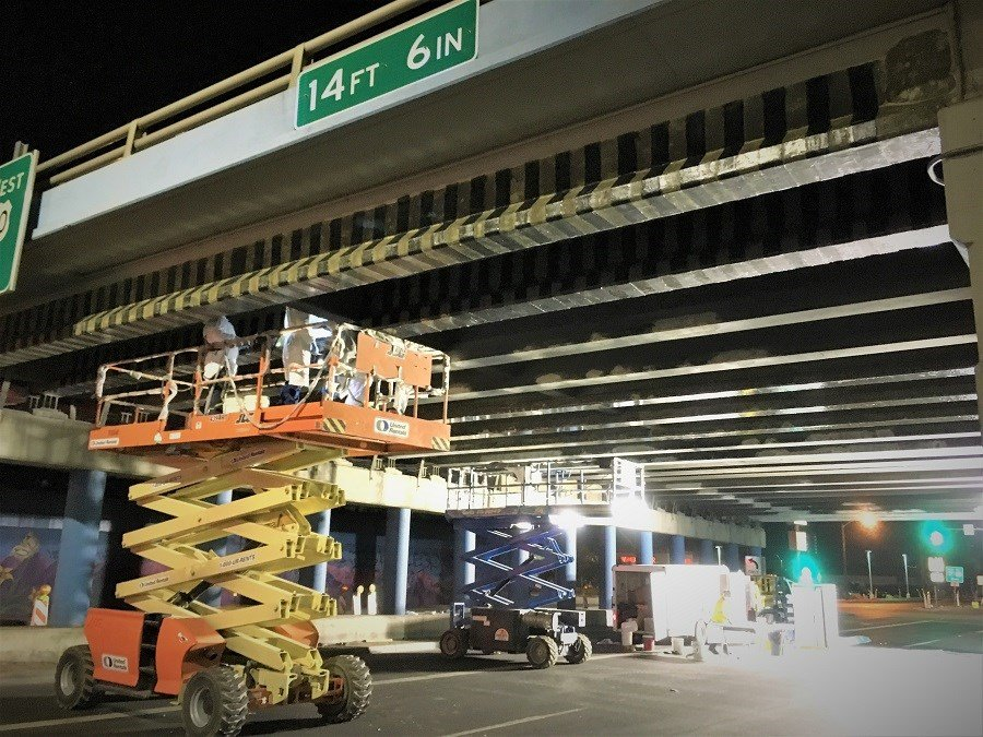 Carbon fiber strips were used to repair and strengthen concrete girders on two freeway bridges in Phoenix. (Source: QuakeWrap)