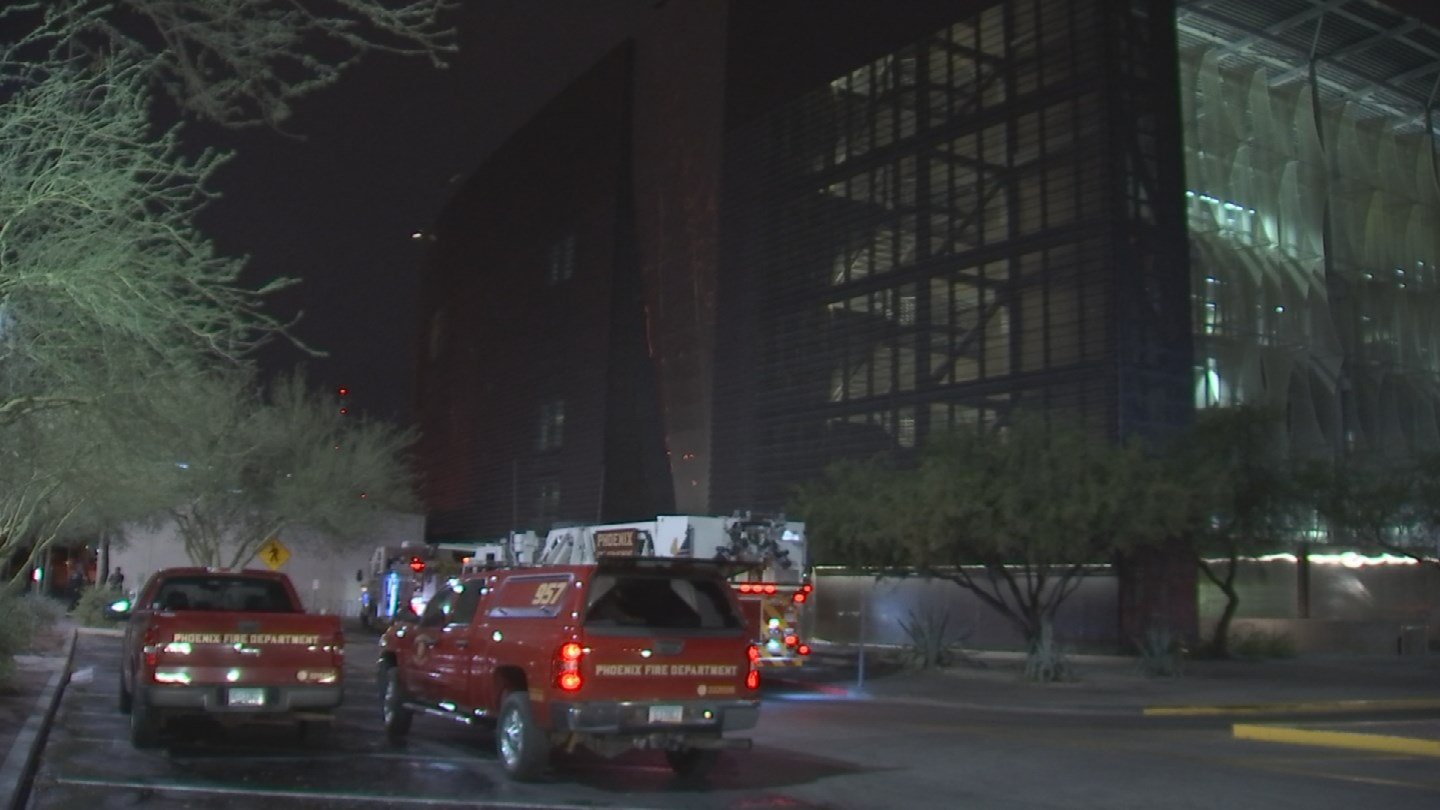 Crews from the Phoenix Fire Department worked through the night to clean up storm damage at the  Burton Barr Central Library. (Source: 3TV/CBS 5)