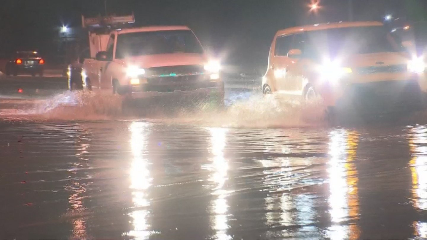 Streets were flooded at the 51st Avenue and Camelback Road intersection. (Source: 3TV/CBS 5)