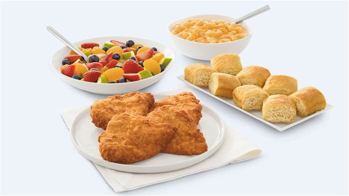 The family take-out option feeds four and includes one entrée, two sides and eight mini rolls. (Source: Chick-fil-A)