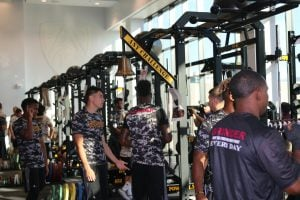 Arizona State football players use the benches in the brand new weight room on Wednesday. (Source: Seth Askelson/Cronkite News)