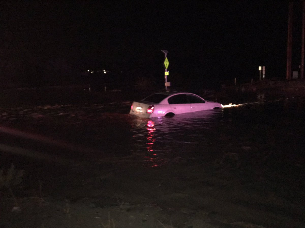 Three people had to be rescued from their vehicle because of flooding. (Source: Queen Creek Fire and Medical Department)
