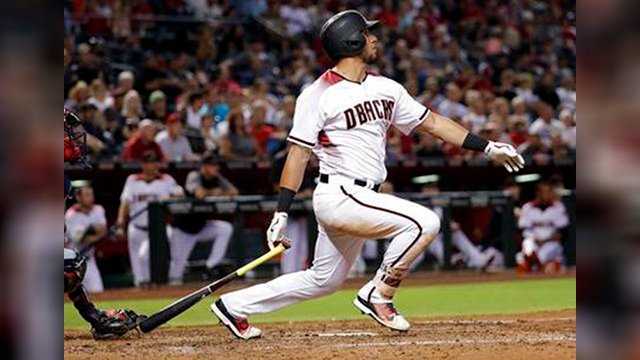 Arizona Diamondbacks David Peralta follows through on an RBI-base hit against the Atlanta Braves during the fourth inning of a baseball game, Monday, July 24, 2017, in Phoenix. (Source: AP Photo/Matt York)
