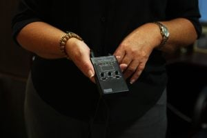 Therapists use this box connected to the headset and paddles to control the frequency and intensity of EMDR therapy. (Source: Lauren Marshall/Cronkite News)