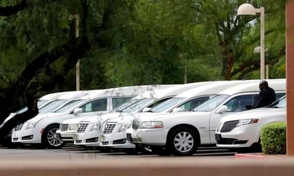Hearses of the family members who were killed in a flash flood are parked outside St. Patrick church, Tuesday, July 25, 2017, in Scottsdale. (Source: AP Photo/Matt York)