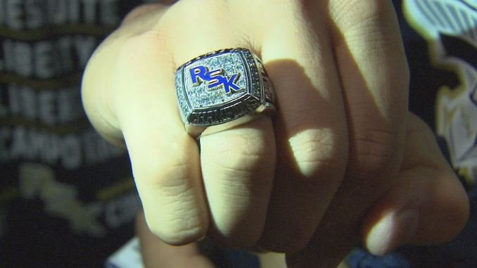 The Kellis Cougars show off their new state championship rings. (Source: 3TV/CBS 5)