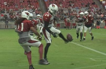 Justin Bethel breaks up a pass to Larry Fitzgerald at Cards Camp. (Source: 3TV/CBS 5)