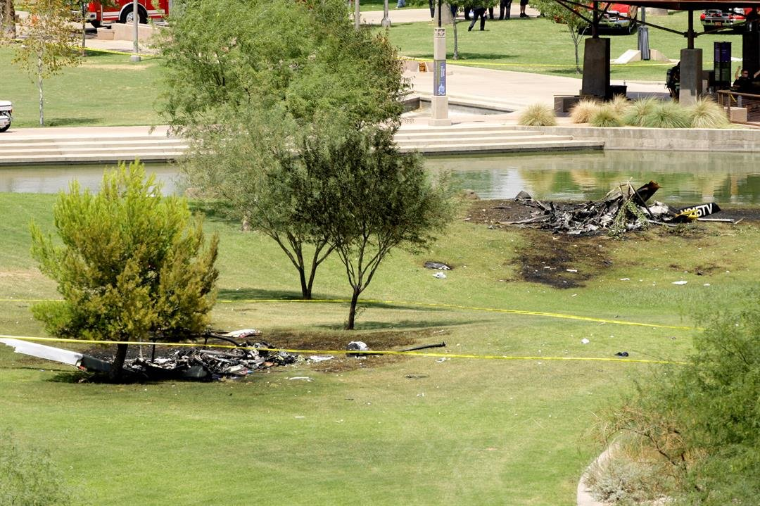 The remains of NewsChopper 3 are in the foreground. (Source: AP Photo/Ross D. Franklin)