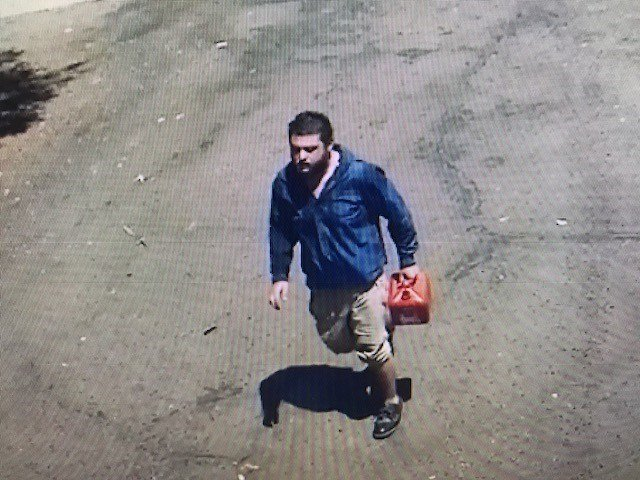 The suspect is seen on video going into the center with a can of gasoline. (Source: Phoenix Fire Department)