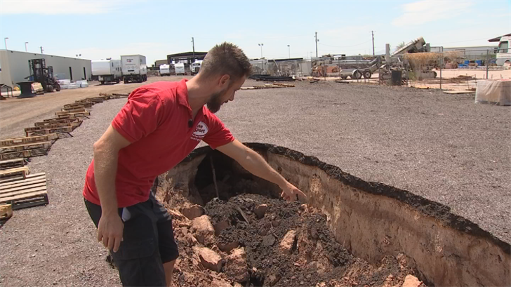 Brad Fanton is furious after a 300-foot fissure opened up on his property Monday, splitting his parking lot. (Source: 3TV/CBS 5)