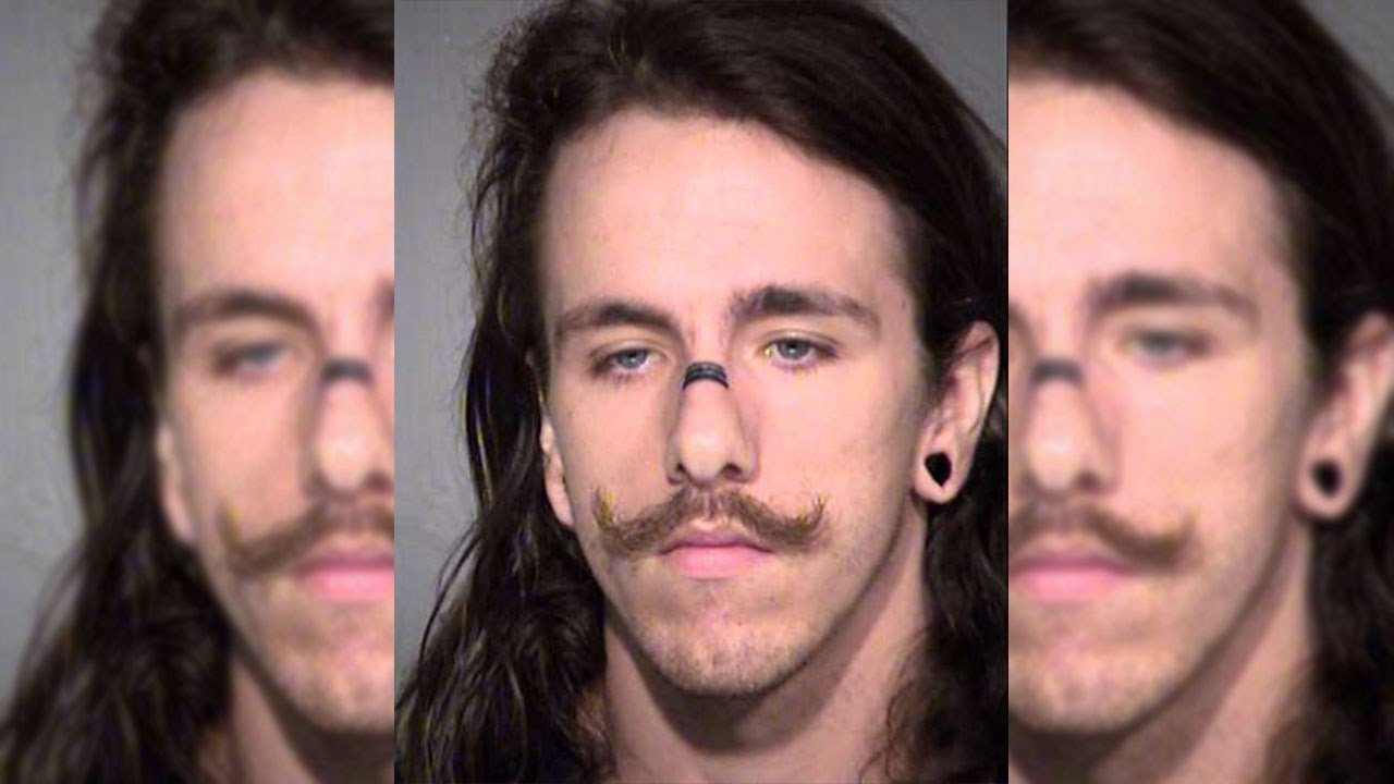 A 22-year-old man was arrested after allegedly posting several nude photographs of his ex-girlfriend to various social media websites. (Source: MCSO)