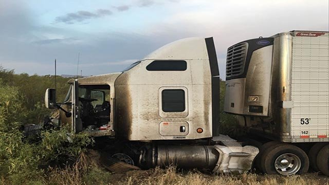 DPS said a four-door passenger car was traveling northbound on U.S. 93 and for an unknown reason crossed the center-line, striking a southbound semi-truck head on. (Source: DPS)
