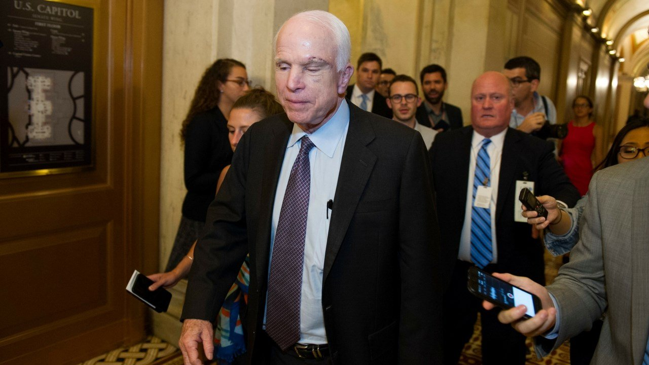 Sen. John McCain, R-Ariz., who returned to Capitol Hill this week after being diagnosed with an aggressive type of brain cancer, smiles as he heads to his office on Capitol Hill in Washington, Thursday, July 27, 2017 (AP Photo/J. Scott Applewhite)