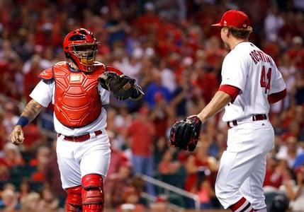 St. Louis Cardinals catcher Yadier Molina, left, congratulates relief pitcher Trevor Rosenthal after Rosenthal struck out Arizona Diamondbacks' Paul Goldschmidt in the eighth inning of a baseball game Friday, July 28, 2017, in St. Louis. (Jeff Roberson)