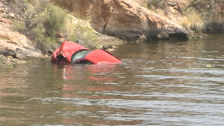 The man only had minor injuries after crashing his truck into Canyon Lake. (Source: 3TV/CBS 5)