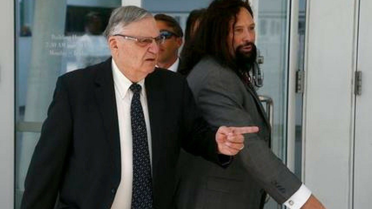 FILE--In this June 26, 2017, file photo, former Maricopa County Sheriff Joe Arpaio, left, leaves U.S. District Court on the first day of his contempt-of-court trial with attorney Mark Goldman, right, in Phoenix. (AP Photo/Ross D. Franklin, file