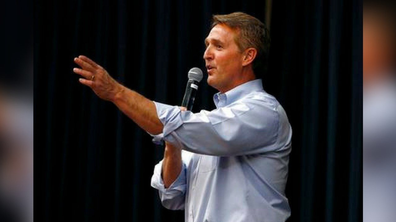 "In this April 13, 2017 photo, Arizona Republican Sen. Jeff Flake takes a question from the audience during a town hall in Mesa, Ariz. The debut of Flake's book ""Conscience of a Conservative"" goes on sale on Tuesday, Aug. 1. (AP Photo/Ross D. Franklin)"