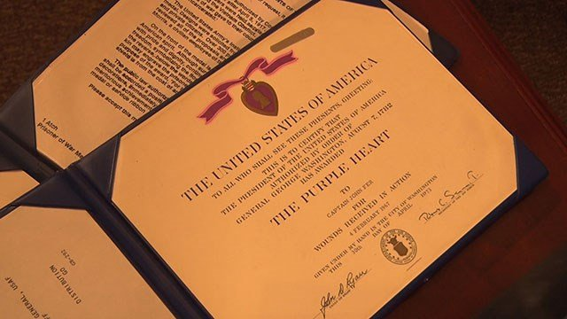 The Purple Heart that John Fer earned in Vietnam. Fer, who spent time as a prisoner of war with Sen. John McCain, R-Arizona, said he prays daily for McCain, who was diagnosed with brain cancer. (Source: Noelle Lilley/Cronkite News)