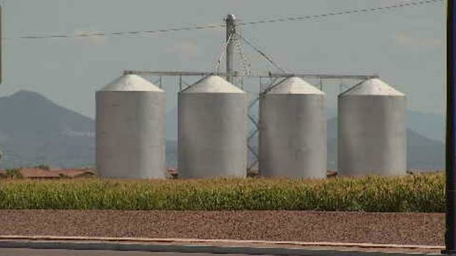 A fence is now up around these massive and very visible grain silos off of Higley Road, known as the tanks, in preparation for what's to come. (Source: 3TV/CBS 5)
