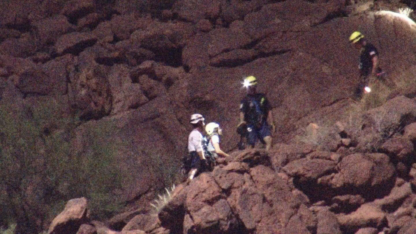 Phoenix and Tempe firefighters were able to safely remove a 22-year-old woman off of Camelback Mountain overnight. (Source: 3TV/CBS 5)