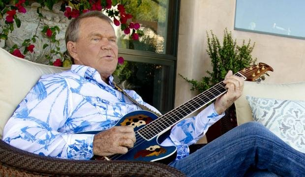 Musician Glen Campbell poses for a portrait July 27, 2011, in Malibu, Calif. (Source: AP file photo)